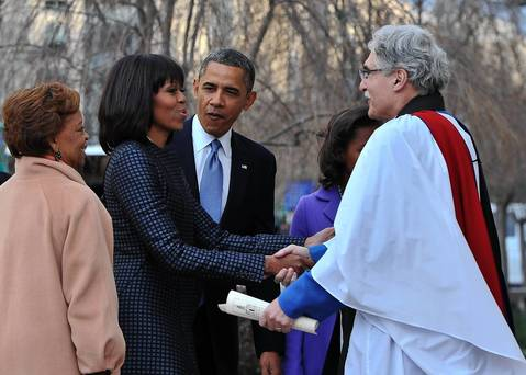 President Barack Obama, first lady Michelle Obama and her mother Marian Robinson are greeted by Rev. Luis Leon as they arrive at St. John's Church in Washington, DC, hours before Obama participates in a ceremonial swearing in for a second term in office.