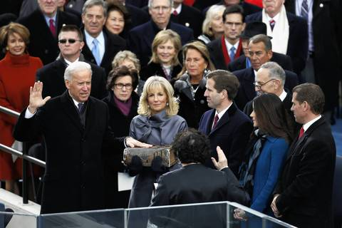 Vice President Joe Biden is sworn-in as his wife Jill holds the bible for him during the 57th Presidential Inauguration ceremonial swearing-in at the U.S. Capitol