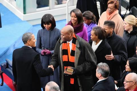 President Barack Obama greets his family upon arriving on stage for his second inauguration at the U.S. Capitol.