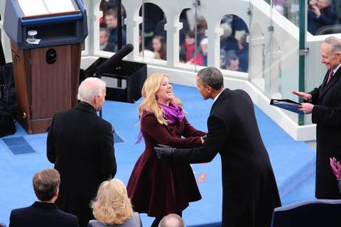 President Barack Obama greets singer Kelly Clarkson during inauguration ceremonies for Obama's second inauguration.