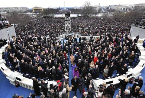 President Barack Obama and his family exit the stage after his inauguration.