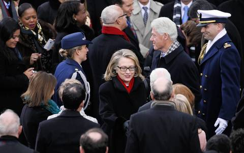 Departing Secretary of State Hillary Clinton and former U.S. President Bill Clinton attend the inauguration ceremony for President Barack Obama at the U.S. Capitol.