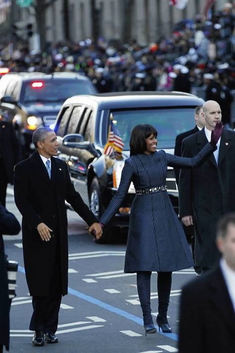President Barack Obama and first lady Michelle Obama walk a portion of the way during the Inaugural Parade in Washington, D.C.