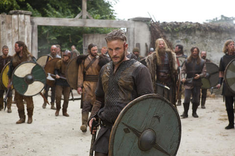 """Ragnar Lothbrok (Travis Fimmel) is based upon the real-life Viking leader who exploded out of Scandanavia and onto the world stage in the 8th Century. According to History, """"Vikings"""" will chart """"Ragnar's ambitions to discover civilizations across the great ocean to the west as well as his inevitable conflicts along the way. With the help of his jester friend Floki (Gustaf Skarsgard), they build a new generation of boats--faster, sleeker and more beautifully crafted than anything else on the sea."""""""