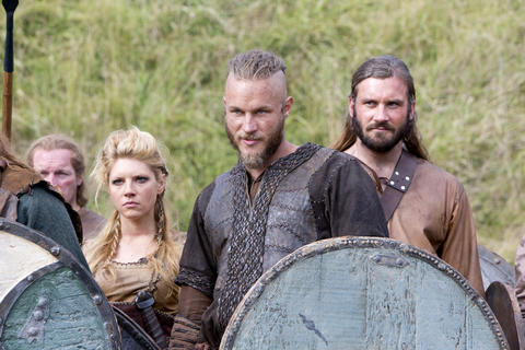 Lagertha (Katheryn Winnick), Ragnar (Travis Fimmel) and Rollo (Clive Standen, right) prepare for battle.