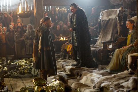 Ragnar Lothbrook (Travis Fimmel) standing before Earl Haraldson (Gabriel Byrne)
