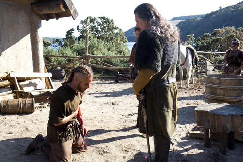 Ragnar (Travis Fimmel) bows down to Earl Haraldson (Gabriel Byrne), the leader of his group.