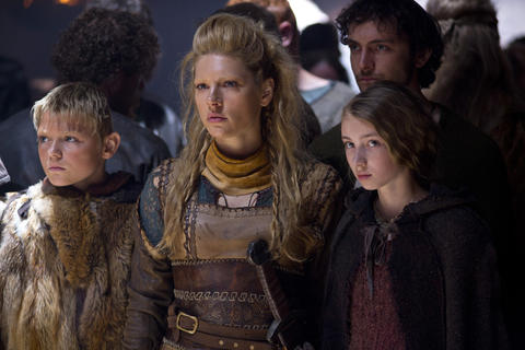 Lagertha (Katheryn Winnick, center), Ragnar Lothbrok's wife, and their children, Bjorn (Nathan O'Toole) and Gyda (Ruby O'Leary), watch as Ragnar goes before Earl.