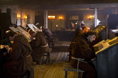 Monks studying, translating or writing.