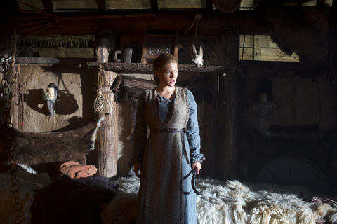 The fierce shieldmaiden Lagertha (Katheryn Winnick) protects herself and her home.
