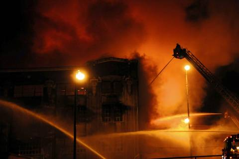 Firefighters battle the 5-11 alarm fire in Bridgeport.