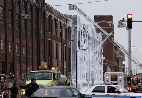 Ice covers the facade of an abandoned warehouse the morning after it caught fire on South Ashland Avenue in Chicago.