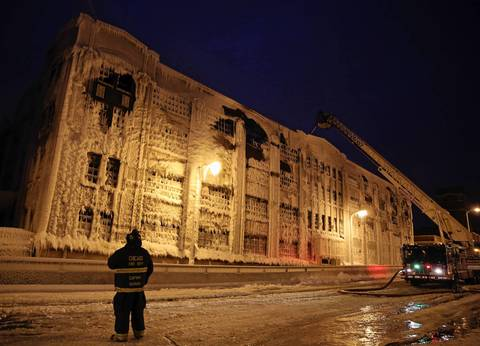 Chicago Fire Dept. captain Jimmy Hannon watches firefighters finish extinguishing a blaze at an abandoned warehouse on South Ashland Avenue in Chicago.