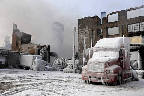 Frozen vehicles remain at the scene of 5-11 alarm warehouse fire on South Ashland Avenue in Chicago, two days after the fire prompted the largest fire department response in years.