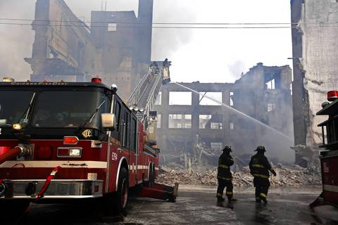 Chicago firefighters return to the scene of 5-11 alarm warehouse fire on South Ashland Avenue in Chicago, two days after the fire prompted the largest fire department response in years. Hot spots continue to flare up.