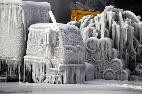 A truck sits frozen in time at the scene of 5-11 alarm warehouse fire on South Ashland Avenue in Chicago, two days after the fire prompted the largest fire department response in years.