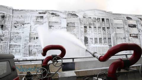"The Chicago Fire Department shoots water at the Bridgeport warehouse with a piece of equipment from the 1960s dubbed ""Big Mo"" that can shoot 2,000 to 3,000 gallons of water a minute from two turrets fed by up to 10 water lines."