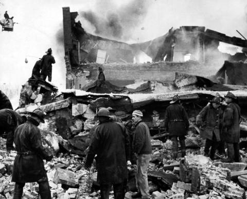 Rescue workers hunt through the ruins for survivors at Mickelberry's Food Products warehouse after the building was torn apart by an explosion on Feb. 7, 1968. Nine people died in the fire, including four firefighters.