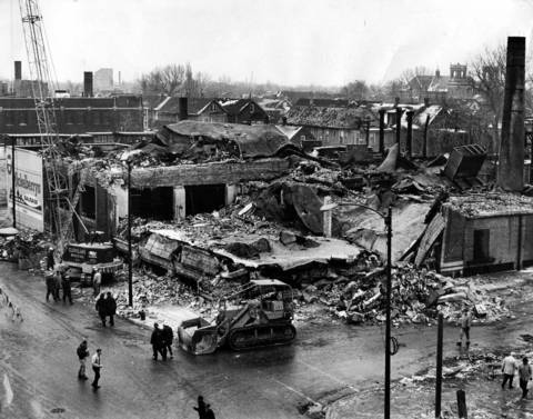 Cleanup begins at Mickelberry's Food Products plant the morning after the explosion, Feb. 8, 1968, that killed nine people. A crane and a bulldozer were on hand to start removing debris from the streets and sidewalks and to demolish any portions of the building still considered hazardous. The view is toward the southwest from Halsted Street and 49th Place.