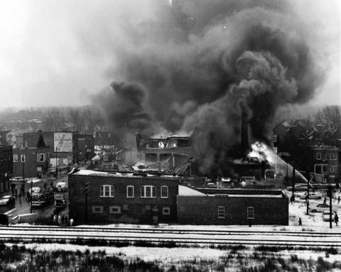 A fire rages at Mickelberry's Food Products plant caused by gas that leaked into the basement, igniting the boiler, and causing two initial explosions on February 7, 1968. This photo was taken shortly before the structure was blown apart by a third and larger explosion. The outline of the gas truck that caused the explosion can be seen parked in the alley behind the building (on the right), which was located at 49th Place and Halsted Street in Chicago.