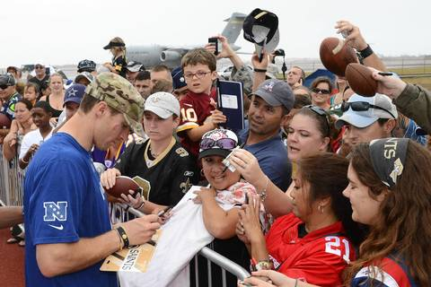 NFC quarterback Drew Brees of the Saints autographs items for fans during practice at Joint Base Pearl Harbor-Hickam.