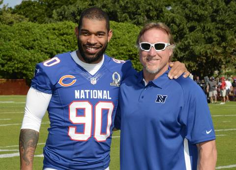Julius Peppers poses with Packers linebackers coach Kevin Greene at NFC Media Day.