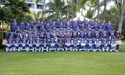 NFC players and coaches pose for a team photo.