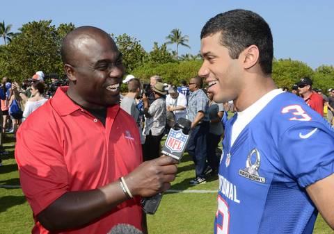 Marshall Faulk interviews Seahawks quarterback Russell Wilson at NFC Media Day.