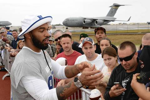 Julius Peppers signs autographs for fans at Joint Base Pearl Harbor-Hickam.