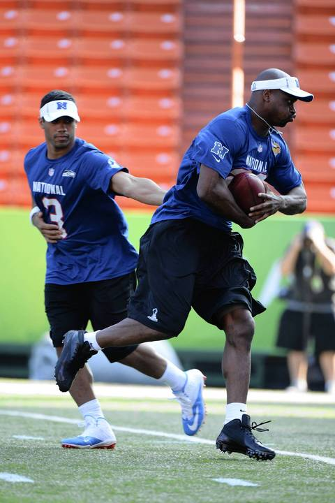 Running back Adrian Peterson receives the ball from quarterback Russell Wilson.