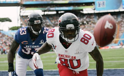 Charles Tillman follows Texans wide receiver Andre Johnson after he missed a pass during the first quarter at Aloha Stadium in Honolulu.