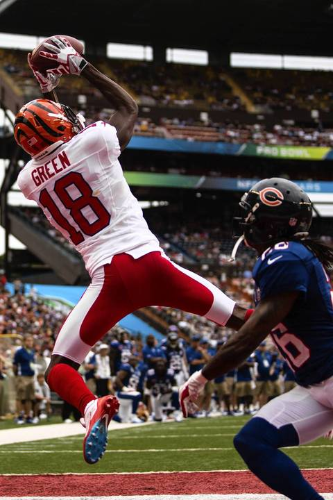 The Bengals' A.J. Green catches a pass over Tim Jennings.