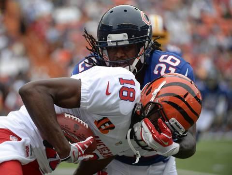 Bears cornerback Tim Jennings tackles Bengals receiver A.J. Green during the 2013 Pro Bowl at Aloha Stadium.