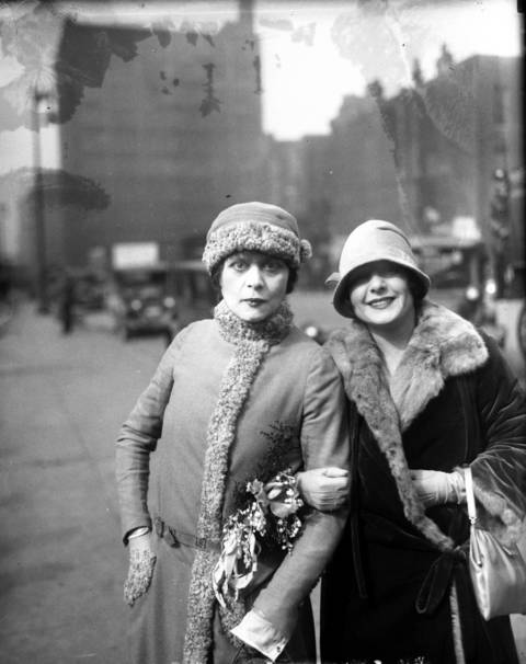 "Movie stars Theda Bara, left and Norma Talmadge in Chicago, March 20, 1926. Bara, nicknamed 'The Vamp' was a successful silent film actress and an early sex symbol. Talmage was also a very successful silent film actress, whose voice, it's been said, ""didn't lend itself to sound."""