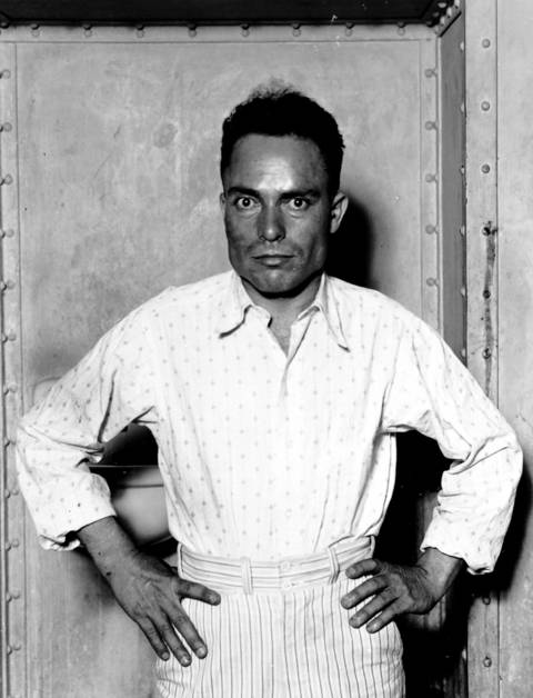Assassin Giuseppe Zangara, an Italian immigrant with a ferocious hatred for politicians, strikes a defiant pose in a Miami jail. He was executed two weeks after the death of Chicago Mayor Anton Cermak, who he killed intending to shoot Franklin Roosevelt.