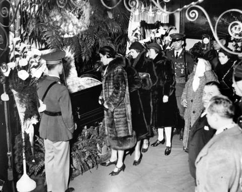 The scene inside the mayor's residence at 2348 South Millard Avenue as mourners file past the bronze casket holding Mayor Anton Cermak in March 1933. Thousands entered the home during the afternoon and evening. The body was then taken to city hall, to lie in state until the funeral, which was held at the Chicago Stadium.