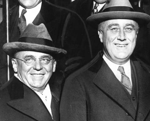 Franklin D. Roosevelt, right, is greeted by Anton Cermak, left, in Chicago on December 1929. Roosevelt and Cermak had yet to ascend to their respective positions as President of the United States and Mayor of Chicago.