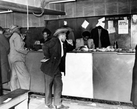 In 1949 women clerks, who were eventually arrested, sell numbers for the policy game to customers just before a police raid at 610 E. 50th Street, Chicago, Ill.