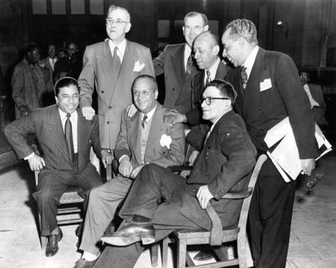 Clifford Davis, left, Edward Jones, center, and Theodore Roe (all seated) were found not guilty in the policy racket on Feb. 5, 1952 by Judge Wilbert F. Crowly. The three policy chiefs were accused of a gambling conspiracy and were freed on directed verdict. Their attorneys are Frank McDonnell, from left, John Coghlan, Joseph Clayton, and Aaron Payne.
