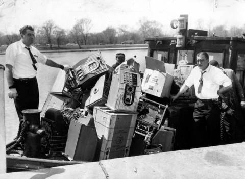 A watery grave 13 miles out in Lake Michigan awaited these slot machines seized from a manufacturing company on West Washington Street in Chicago in 1960. The machines were loaded onto a barge at Jackson Park yacht harbor on April 21, 1960 and taken 13 miles out and dumped into Lake Michigan.