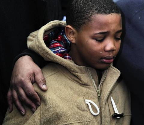 Hadiya Pendleton's brother Nathaniel Pendleton Jr. is embraced by his father Nathaniel Pendleton during a press conference in Harsh Park in Chicago. Officials announced a reward for information in the shooting death of the Hadiya Pendleton.