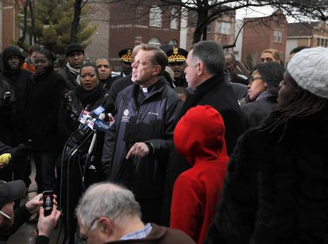 Rev. Michael Pfleger speaks at a press conference in Harsh Park in Chicago where officials announced a reward for information in the shooting death of Hadiya Pendleton, who was shot and killed in the park a day earlier.