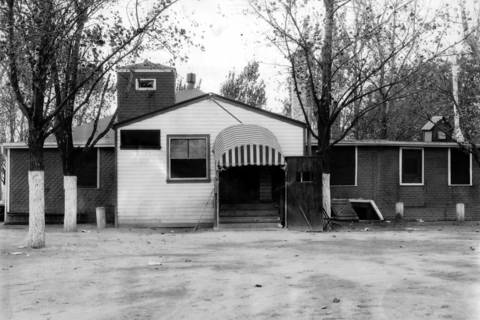 Exterior view of the Dev-Lin gambling house at Lincoln and Devon Avenues in Lincolnwood, Ill, that was raided by the County Highway Police on October 18, 1935.