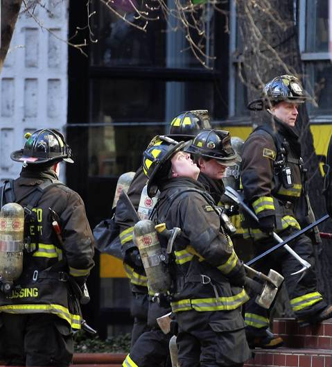 A Chicago firefighters arrive at a high-rise building fire fire in the 200 block of E. Ontario Street in downtown Chicago.