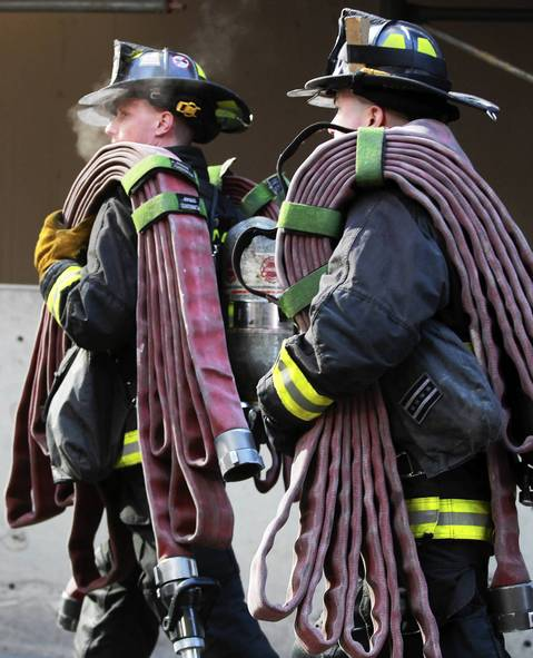 Chicago firefighters arrive on the scene to battle a fire in a high-rise building in the 200 block of E. Ontario Street in Chicago.