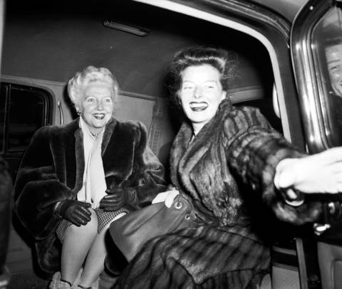 Actress and movie star Katharine Hepburn, right, on her way to visit her mother in Connecticut, is met by Mrs. Loyal Davis (Edith Robbins), Feb. 7, 1947. Robbins is the mother of former First Lady Nancy Reagan.