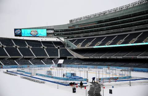 Workers resurface an ice rink in the middle of Soldier Field.