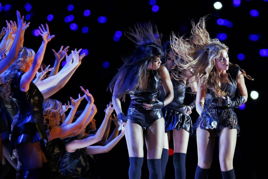 Beyonce (right), Michelle Williams (center), and Kelly Rowland of the former group Destiny's Child perform in the NFL Super Bowl XLVII football game in New Orleans, Louisiana.