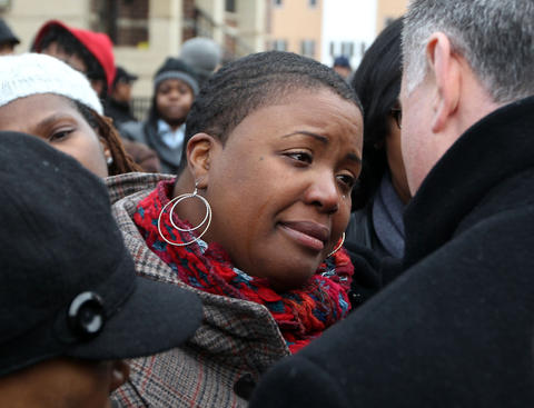 A tearful Cleopatra Cowley-Pendleton talks with Chicago Police Superintendent Garry McCarthy in Harsh Park in Chicago where her daughter was killed the day before.