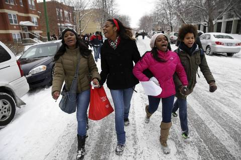 Lindblom Math and Science Academy students Chelsea James, 17, from left; Jordyn Willis, 17; Darnisha Stevenson, 17; and Laila Xhamilton, 18, lead the march from Hadiya Pendleton's school, Dr. Martin Luther King College Prep High School, to Vivian Gordon Harsh Park where she was shot.